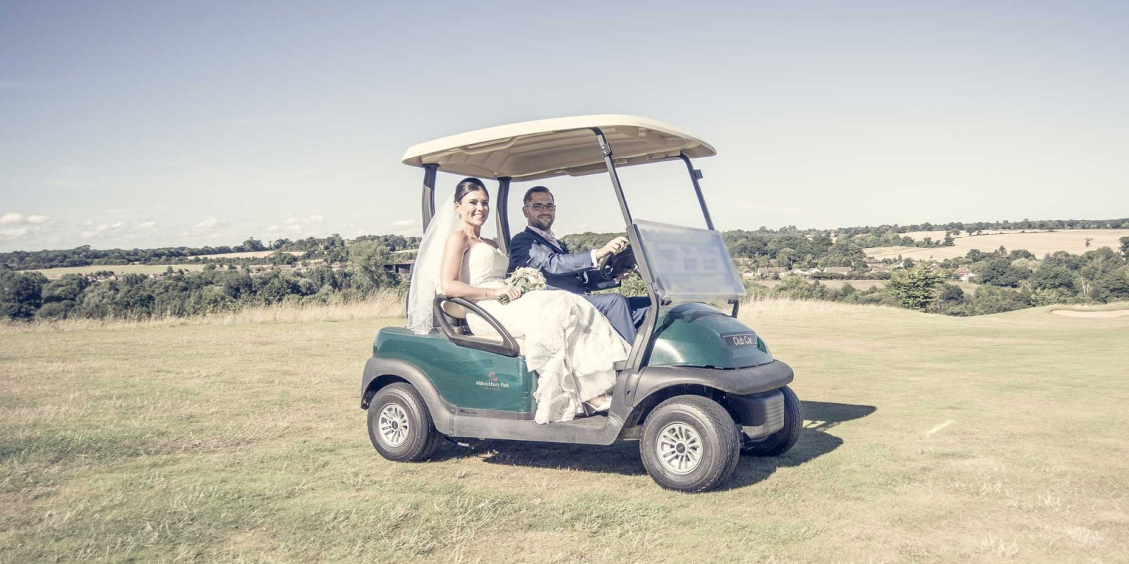 Aldwickbury Park Wedding Couple on Buggy